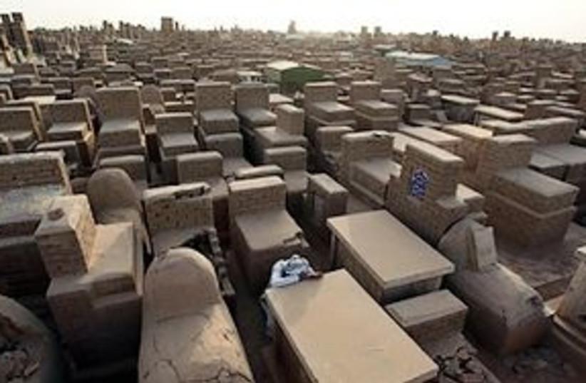 iraq man grieving 311 (photo credit: AP)