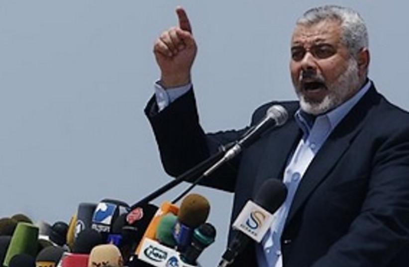 Haniyeh shouting, mikes 311 (photo credit: ASSOCIATED PRESS)