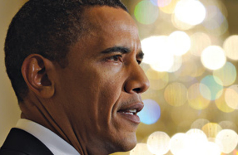 Obama harsh features (photo credit: Associated Press)