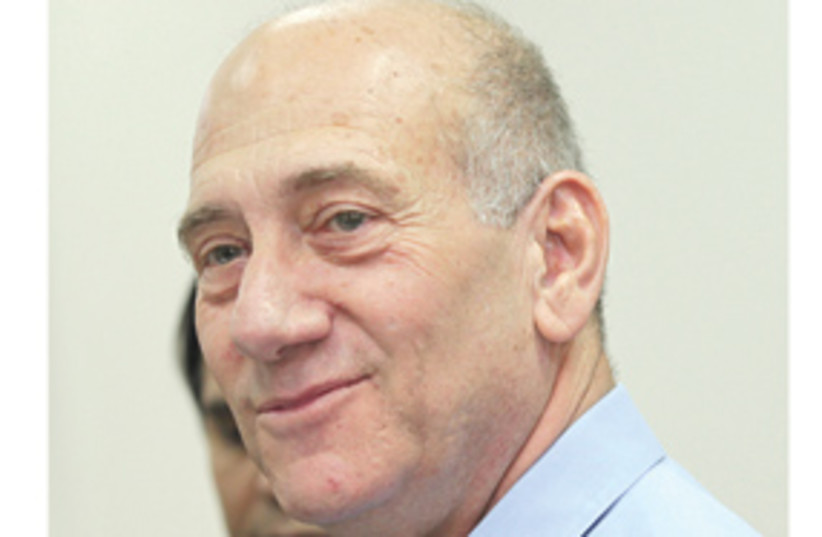 Olmert, smug, with white on the sides 311 (photo credit: Ariel Jerozolimski/The Jerusalem Post)
