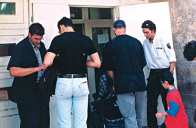 Job seekers 311 (photo credit: Ariel Jerozolimski/The Jerusalem Post)