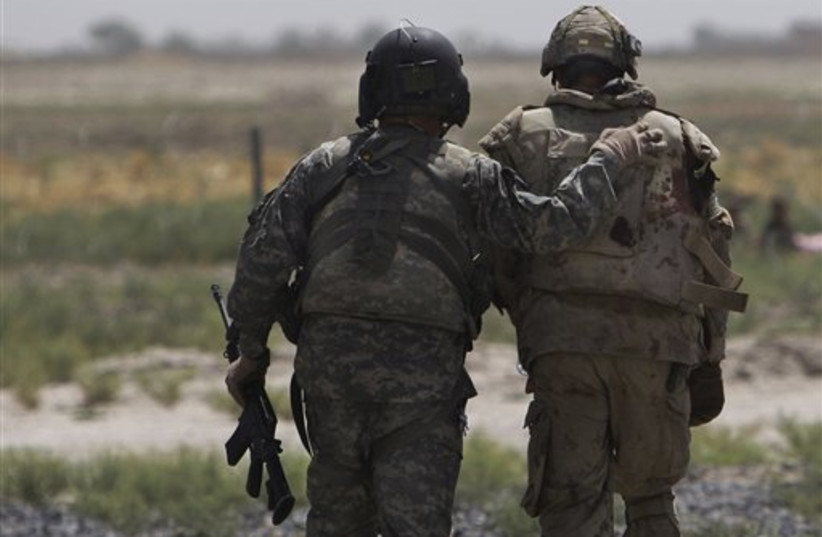 Allied soldiers in Afghanistan (photo credit: AP)