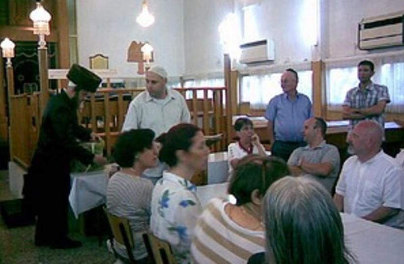 synagogue struggle (photo credit: Courtesy)