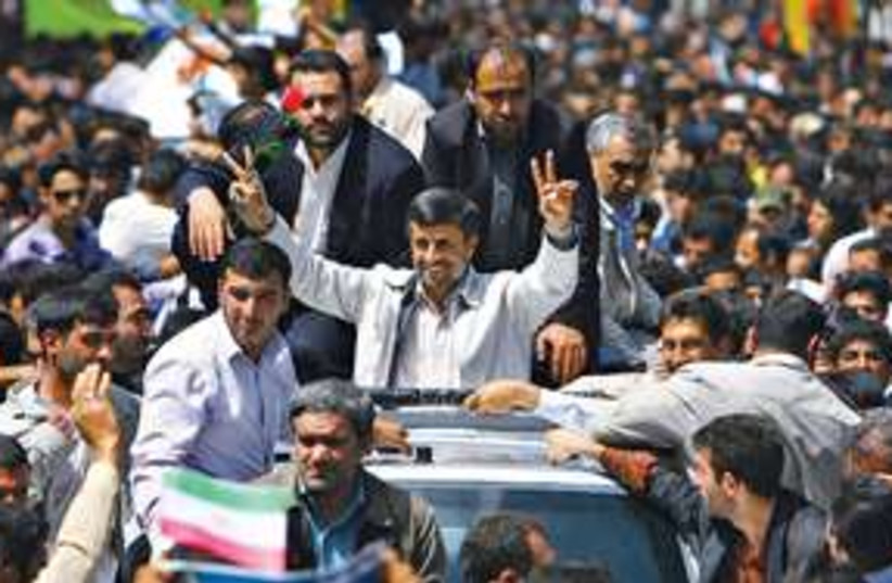 ahmadinejad 311 (photo credit: Amir Kholousi\AP)