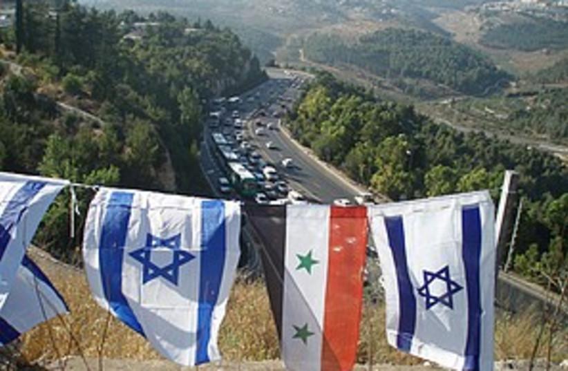 Israel Syria flags 298.8 (photo credit: Courtesy)