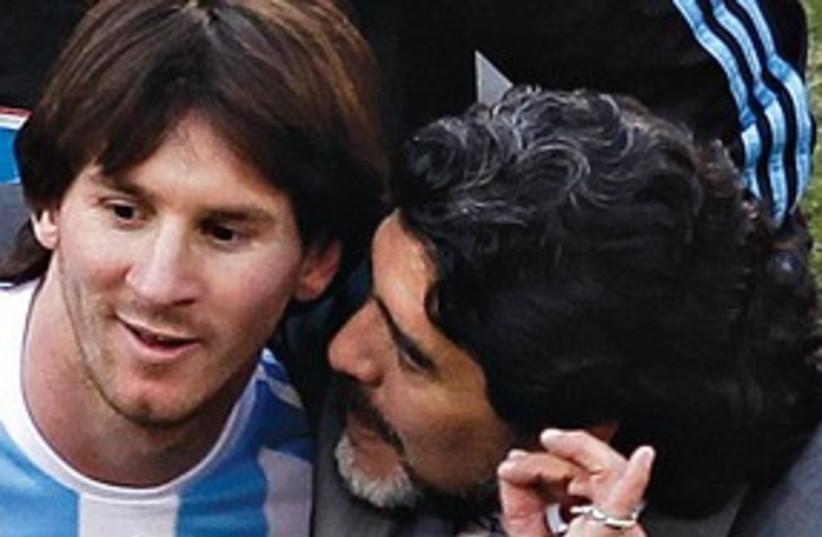 Messi Maradona (photo credit: AP)