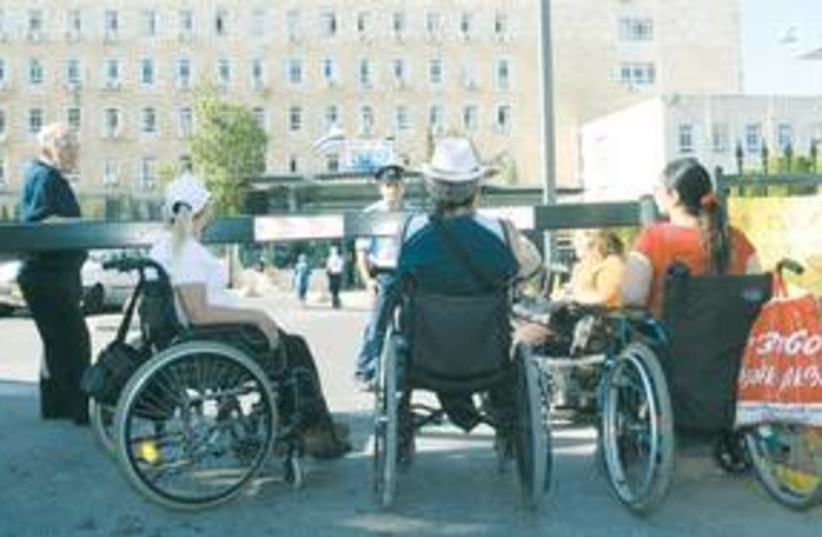 wheelchair 311 (photo credit: Ariel Jerozolimski/The Jerusalem Post))