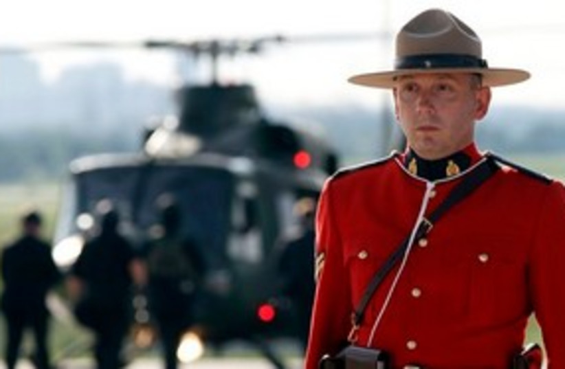 Canadian mounty by G8 helicopter 311 (photo credit: Associated Press)