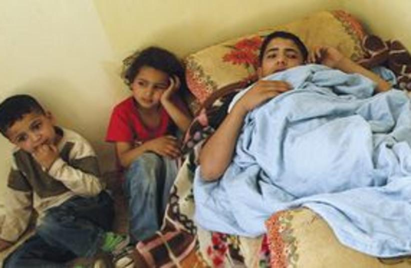 palestinian family 311 (photo credit: Mohammed Ballas/AP)