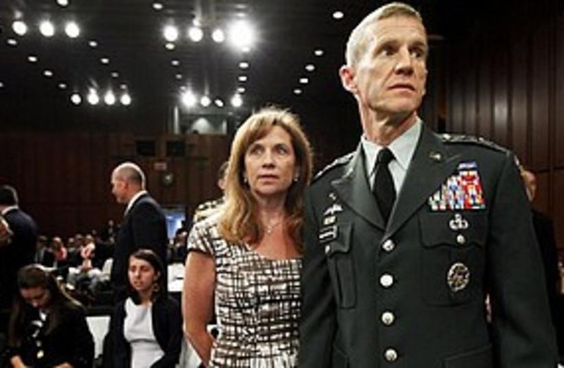 McChrystal + Wife 311 AP (photo credit: Associated Press)