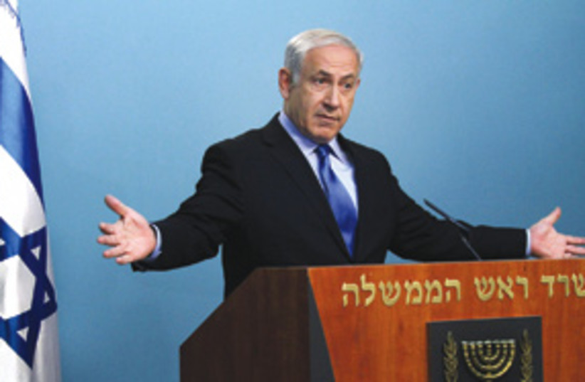 Netanyahu with arms wide open 311 (photo credit: Courtesy)