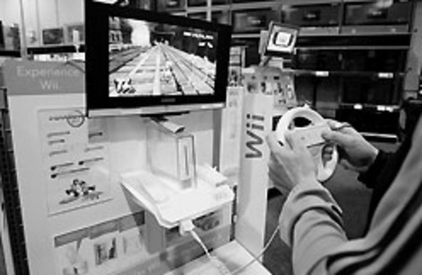 A customer plays a game on a Nintendo Wii at Best  (photo credit: ap)