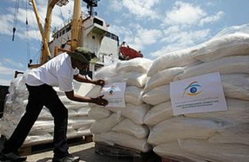 Libyan Aid Ship Loading AP 311 (photo credit: Associated Press)