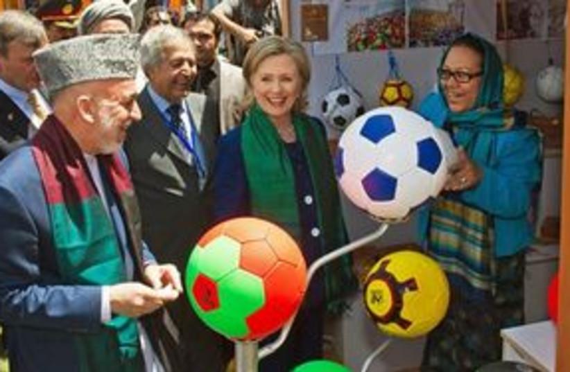 311_Karzai and Clinton (photo credit: Associated Press)