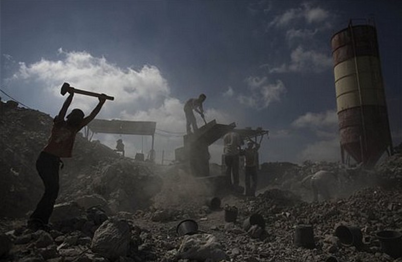 In this photo taken Tuesday, July 20, 2010, Palestinians work to recycle cement at a factory that do
