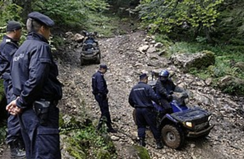 Romania crash search 311 AP (photo credit: Associated Press)