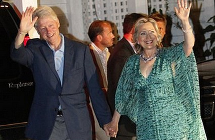Bill  and Hillary Clinton leave a party in honor of Chelsea Clinton and Marc Mezvinsky.