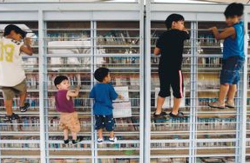 311_foreign workers' kids (photo credit: Ariel Schalit/AP)