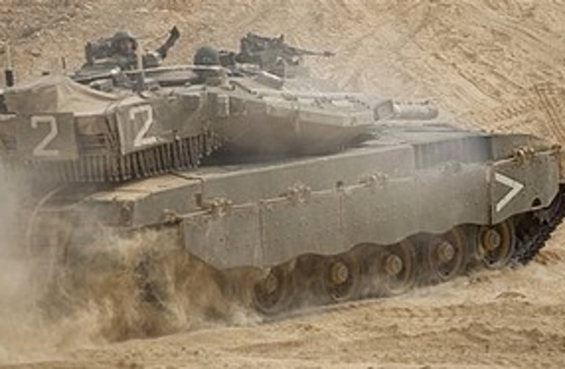 IDF tank lebanon border 311 AP (photo credit: Associated Press)