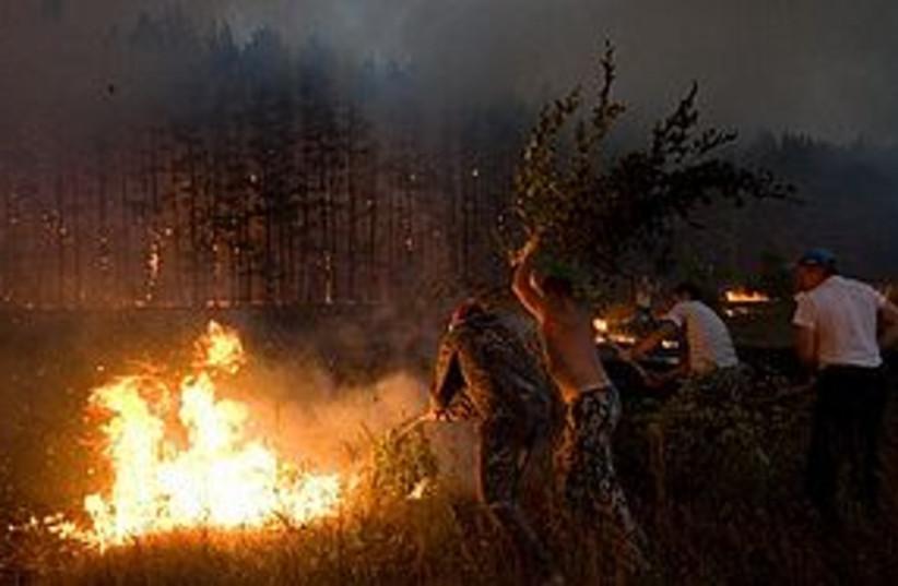russia fire 311 (photo credit: Associated Press)