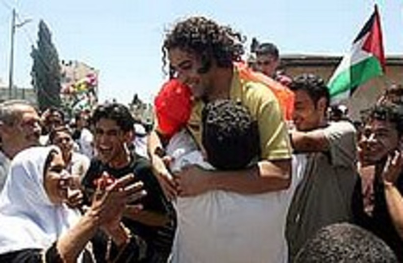 prisoner freed hug 224.8 (photo credit: Ahmad Gharabli)
