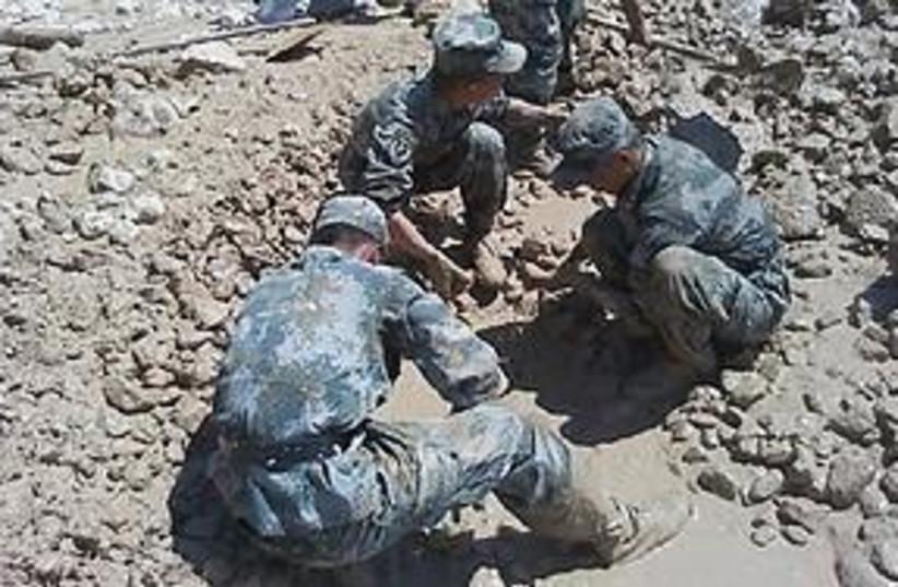 China landslides (photo credit: Associated Press)