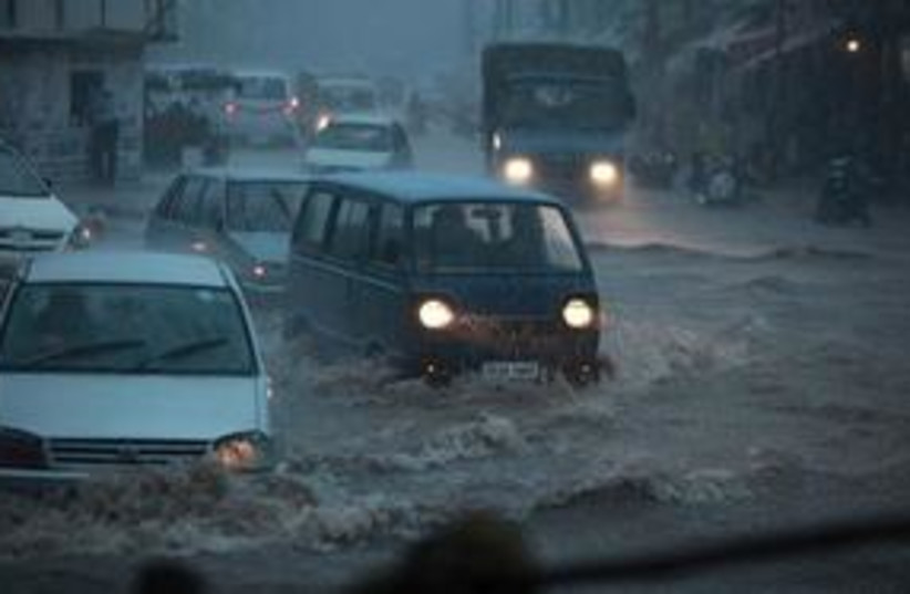 India floods 311 (photo credit: AP Photo/Channi Anand)
