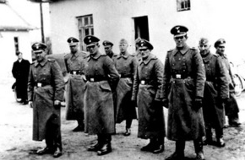 311_Nazi camp guards (photo credit: ASSOCIATED PRESS)