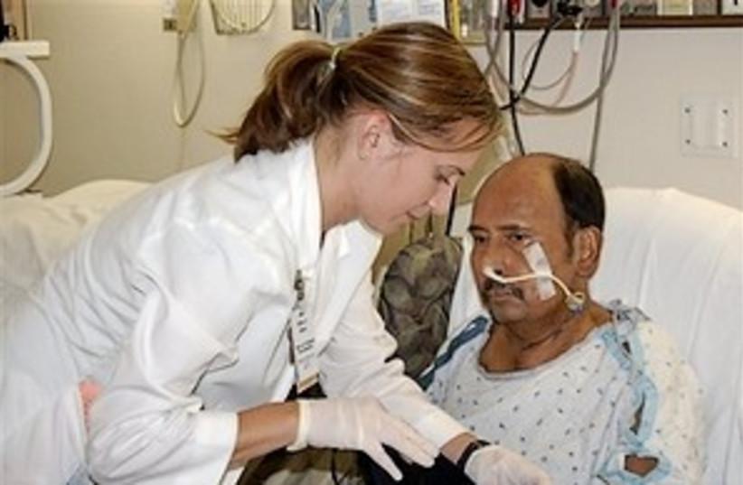 nurse patient 298.88 ap (photo credit: AP)