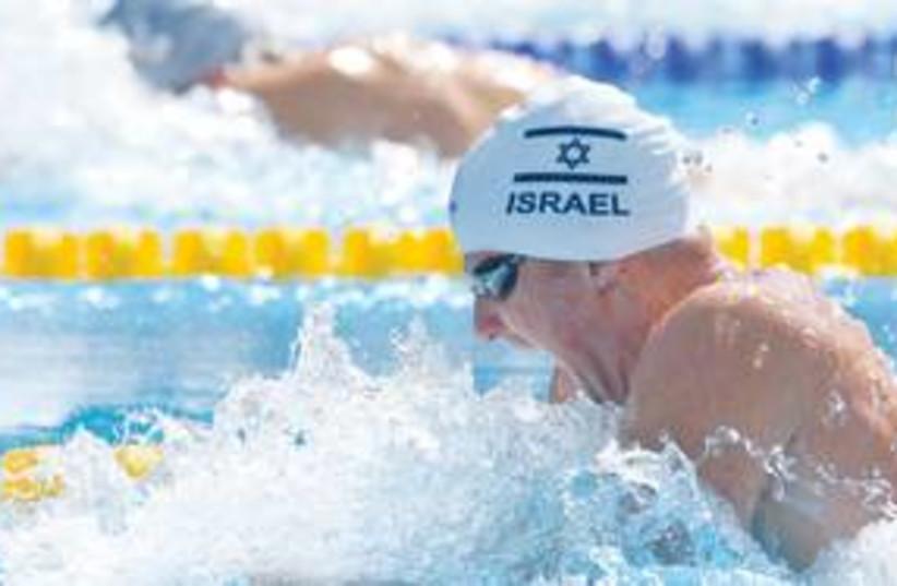 Swimming 311 (photo credit: Associated Press)