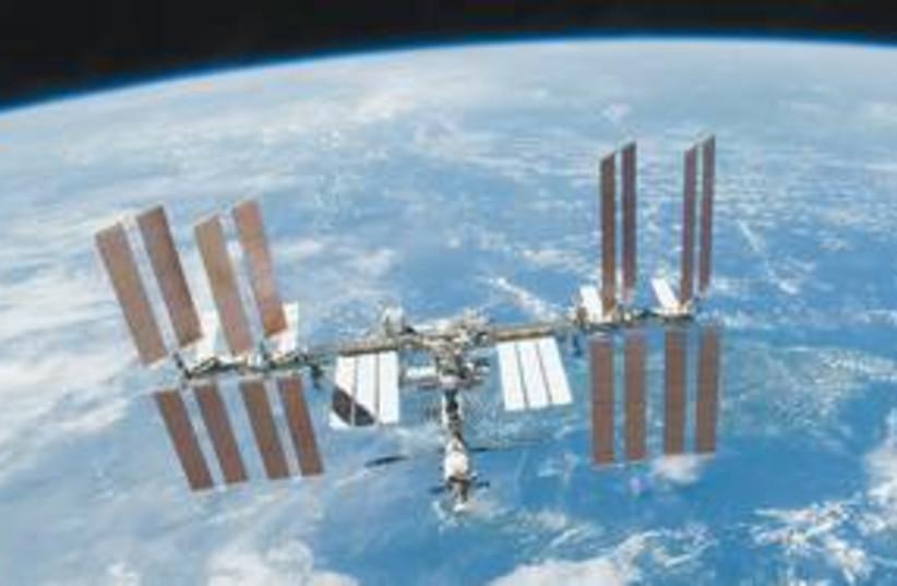 NASA 311 (photo credit: NASA/AP)