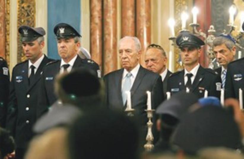 311_Peres at romania crash memorial (photo credit: Associated Press)