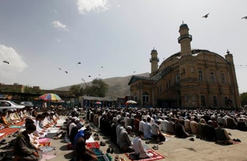 Afghan men offer the first Friday prayers of Ramadan outside a mosque in Kabul, Afghanistan.