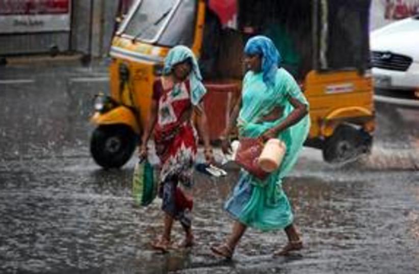 India Rains 311 (photo credit: Associated Press)