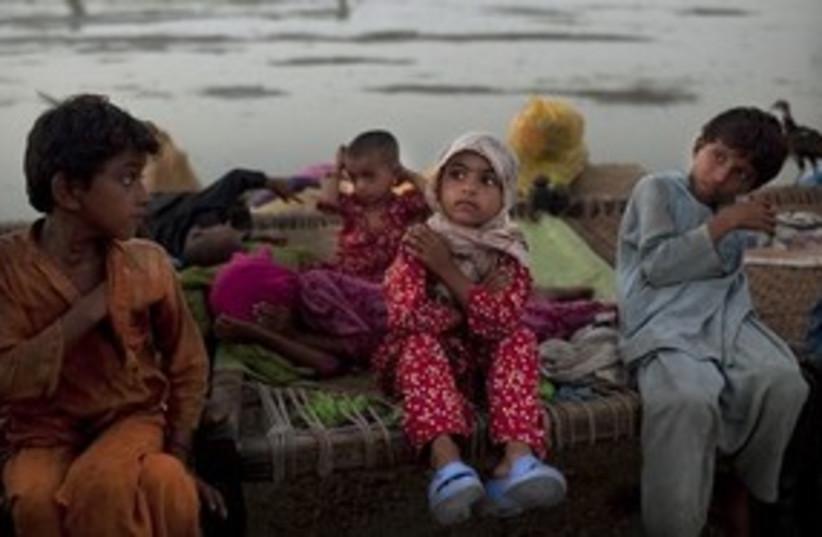 Pakistani children after floods (photo credit: ASSOCIATED PRESS)
