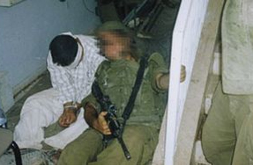 Soldiers Manacled Palestinian 311 (photo credit: Courtesy)