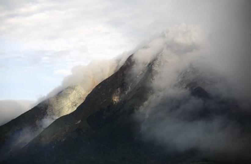 Indonesian volcano Mount Sinabung erupts.