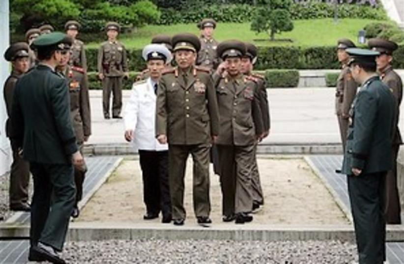 north Korea officers 298 (photo credit: AP)