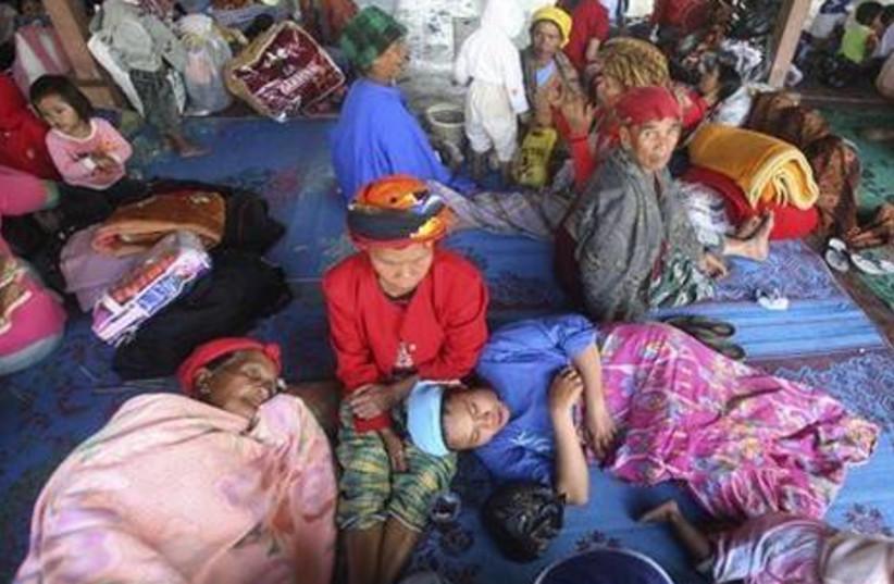 Volcano refugee at aid center.