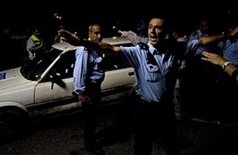 Kiryat arba attack police 311 AP (photo credit: Associated Press)