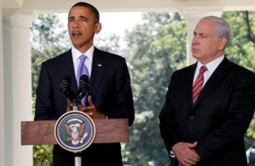 Obama speaks as Bibi looks on 311 (photo credit: Associated Press)