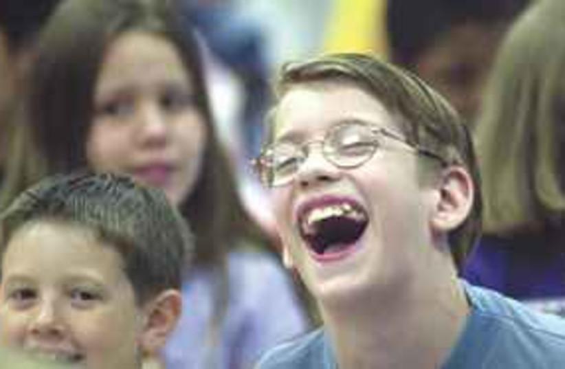 Smiling boy 311 (photo credit: Juan Garcia/Dallas Morning News/MCT))