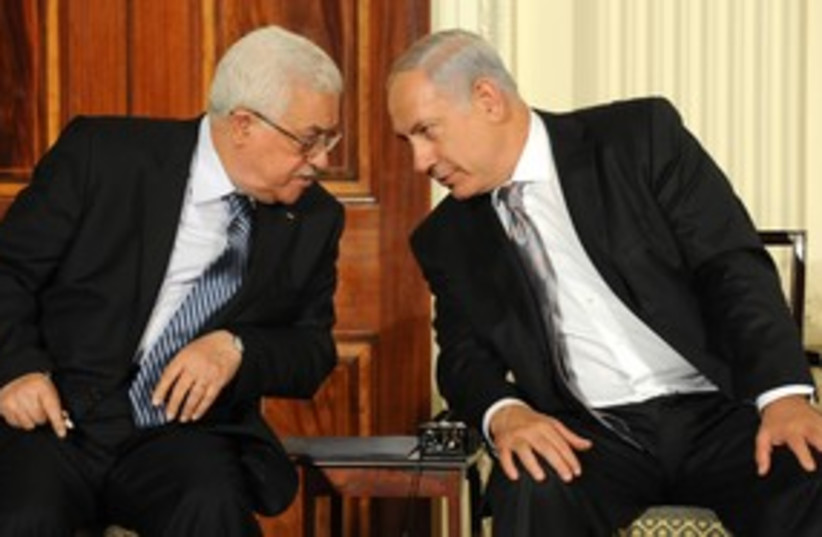 311_Abbas stares down Netanyahu (photo credit: Associated Press)