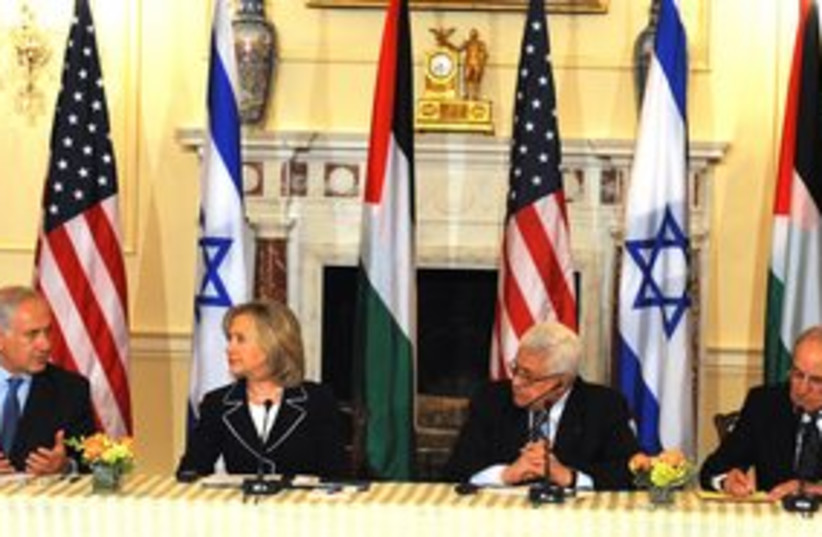 311_Netanyahu, Clinton, Abbas and Mitchell at table (photo credit: Moshe Milner / GPO)