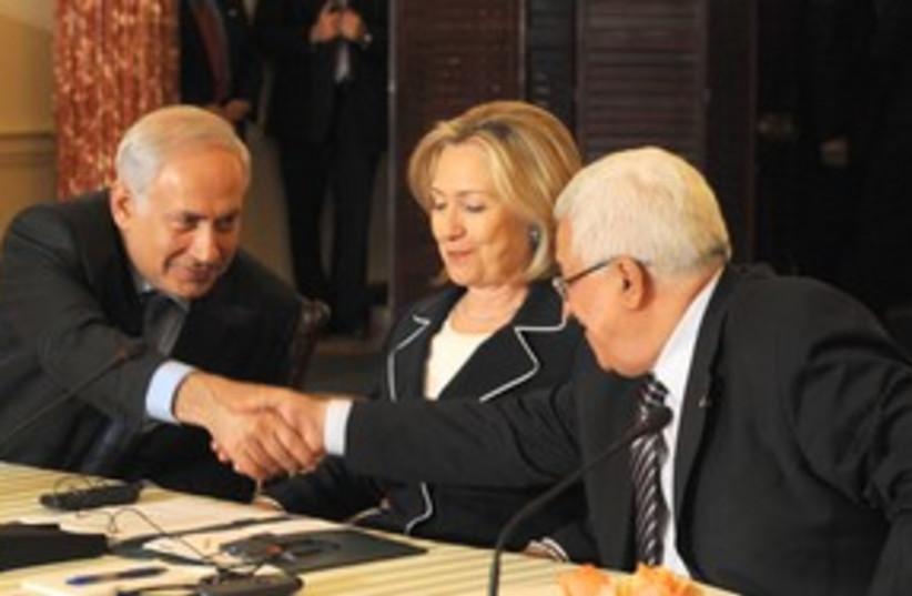 311_Netanyahu, Abbas groping Hillary Clinton (photo credit: Moshe Milner / GPO)