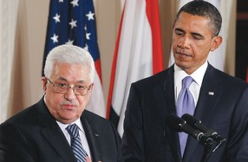 Abbas speaks Obama looks on (photo credit: Associated Press)