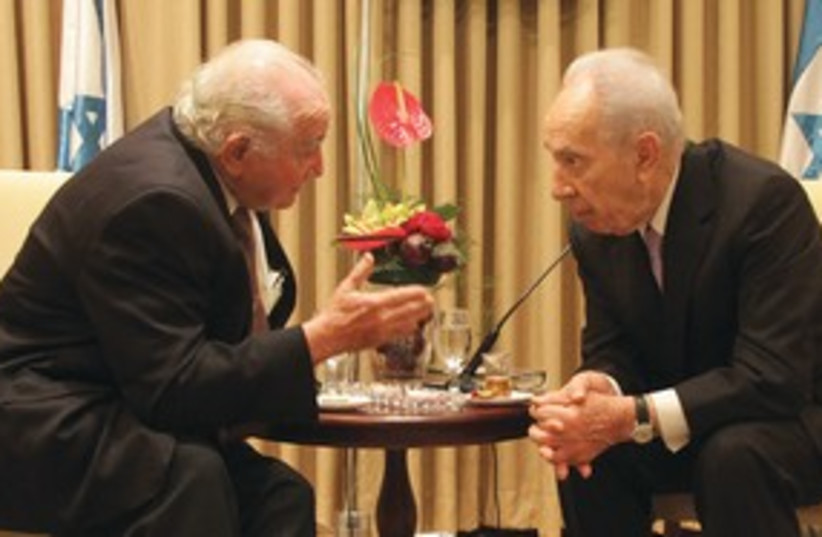 Peres with Aushwitz survivor 311 (photo credit: Yosef Avi Yair Engel)