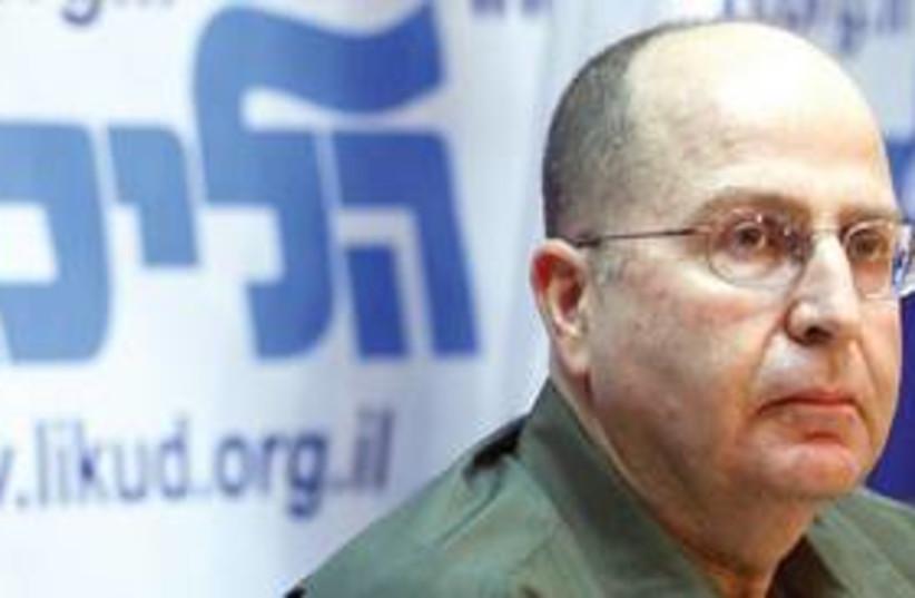 Moshe Ya'alon serious with Likud sign 311 (photo credit: Ariel Jerozolimski)