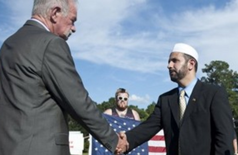 311_Koran book burning averted (photo credit: Associated Press)