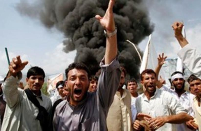 Koran Burning Protest 311 (photo credit: Associated Press)